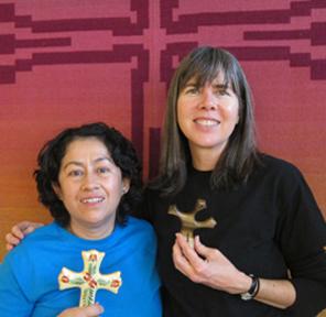 Paz and Denise holding gift crosses